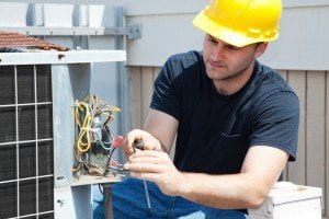 electrician working on air conditioning unit